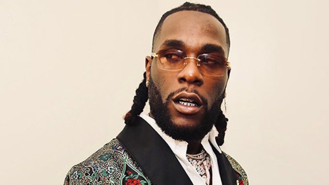 Burna Boy Rocks 3.6 Million Naira Louis Vuitton Backpack During Performance In Belguim